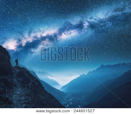 Milky Way, Girl And Mountains. Silhouette Of Standing Woman On The Mountain Peak, Mountains And Star