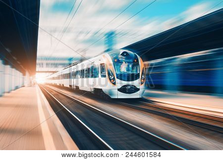 High Speed Passenger Train In Motion On The Railway Station At Sunset In Europe. Modern Intercity Tr