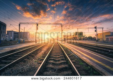 Railway Station And Beautiful Colorful Sky At Sunset. Industrial Landscape With Railroad, Blue Sky W