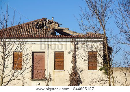 Broken Brick Bags On The Roof Of A Cottage. Damaged Roof