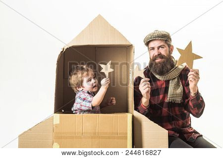 Happy Family Play With Cardboard Rocket. Cosmonaut Concept. Cute Boy Playing Cosmonaut. Children's D