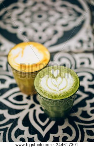 Trendy Multicolored Lattes. Avocado And Turmeric Tastes With Latte Art.