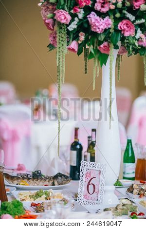 Table Setting At A Luxury Wedding Reception. Wedding Decorations With Flowers. Newlyweds Party Decor