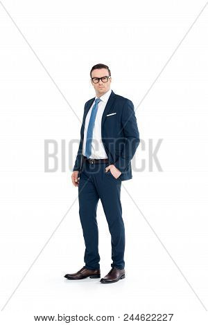 Full Length View Of Confident Businessman In Eyeglasses And Suit Standing With Hand In Pocket And Lo