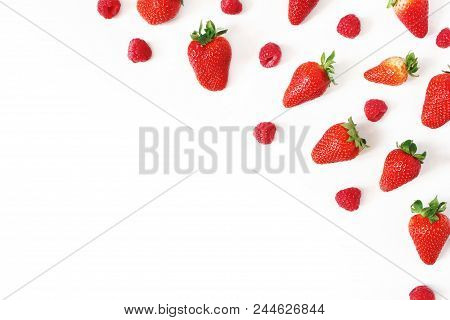 Summer Healthy Fruit Composition With Fresh Red Strawberries And Raspberries Isolated On White Table