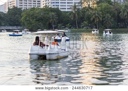 Blurred - at the Lumpini public park of Bangkok Thailand, in holiday People relax on a boat in a city park Bangkok Thailand. poster