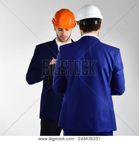 People In Helmets Isolated On White Background. Architects Think About Project. Construction, Busine
