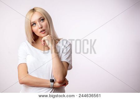 Good-looking Blond Model With Pensive Look. Copy Space. Isolated White Background.sky-hoot. Copy Spa
