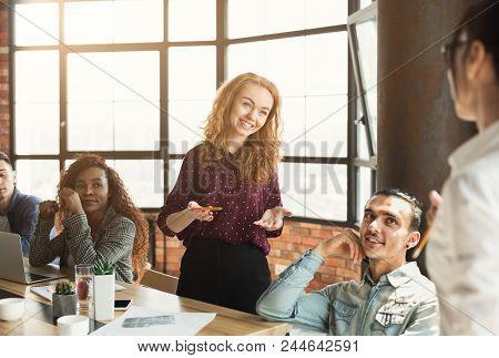 Creative Multiethnic Business Team Meeting In Trendy Boardroom. Office Brainstorming, Business Plan