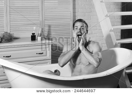 Man In The Bathroom. Sexuality And Relaxation Concept. Guy In Bathroom With Toiletries And Stairs On