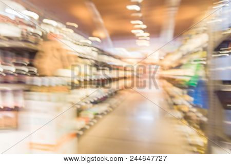 Abstract Blurred Image Of Liquor Shop Customer Shopping