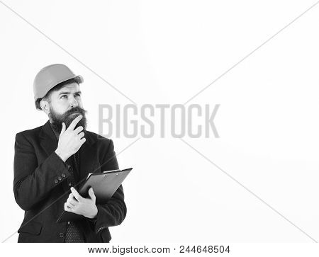 Making Decisions, Thoughts, Management, Profession Concept. Bearded Man Wears Helmet Isolated On Whi
