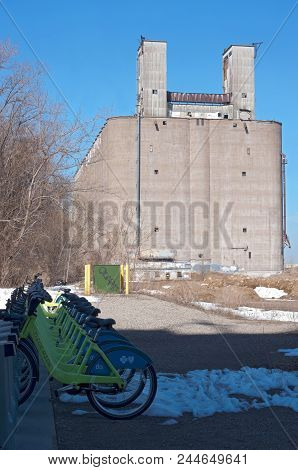 Mpls, Mn/usa - April 22, 2018: Docking Station Of Bicycles Available For Public Use And Grain Elevat