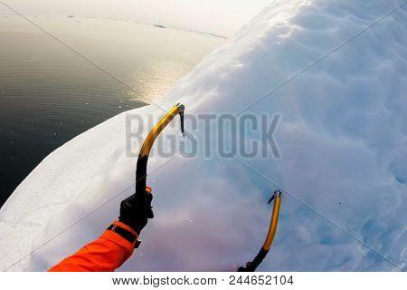 Hooks Climber On The Glacier. The Climber Climbs The Glacier.