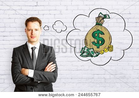 Businessman Thinking About Money Sack On Brick Background. Money And Rich Concept