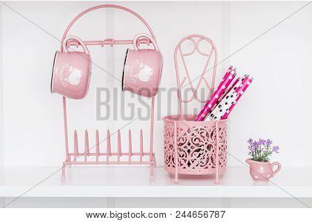 Enamel Look Porcelain Mugs And  Pink Metal Holder On White Shelf