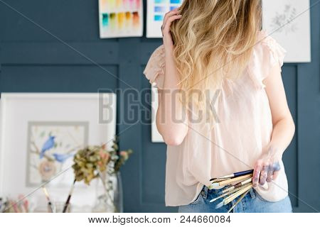 Crafty Room. Artful Studio. Creative Painter Workspace. Paintings Watercolor Drawings On The Wall. A