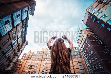 Beautiful Young Pregnant Woman Walking Through The City Streets. Concept Of Motherhood And Pregnancy
