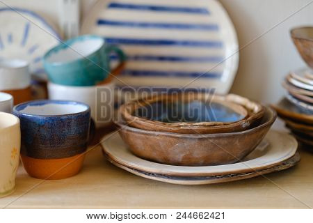 handmade crockery. handicraft pottery. artisan clay plates bowls cups and mugs assortment poster