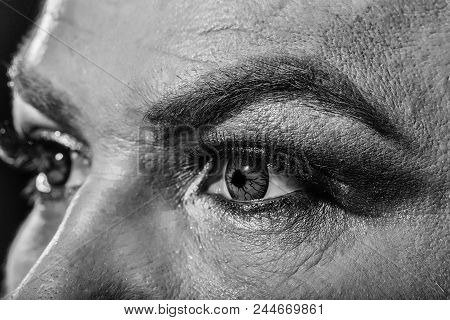 Contact Lenses. Two Male Eyes With Dark Bright Makeup Eyeshadow Hairy Eyebrow And Colored Decorative
