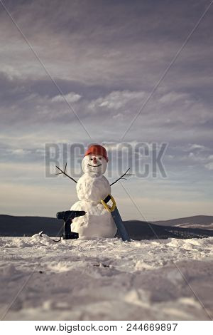 Snowman Builder. New Year Snowman From Snow With Saw And Screwdriver. Happy Holiday And Celebration.
