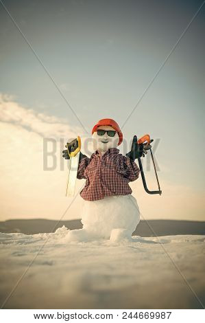 Snowman Builder. Christmas Or Xmas Decoration. Snowman Builder In Winter In Helmet. Happy Holiday An