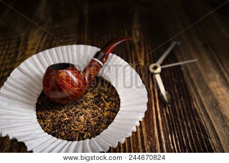 Smoking Pipe With Tobacco Leaves