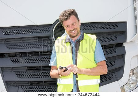 Smiling Handsome Delivery Man Driver Truck Looking His Smartphone App For Deliver