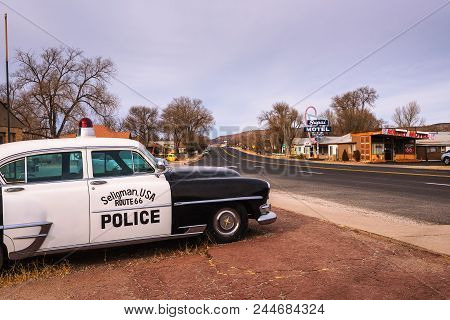 Seligman, Arizona, Usa - January 2, 2018 : Vintage Chrysler New Yorker Police Car Parks On Historic