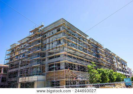 Corner Residential Building Under Construction With Scaffolding