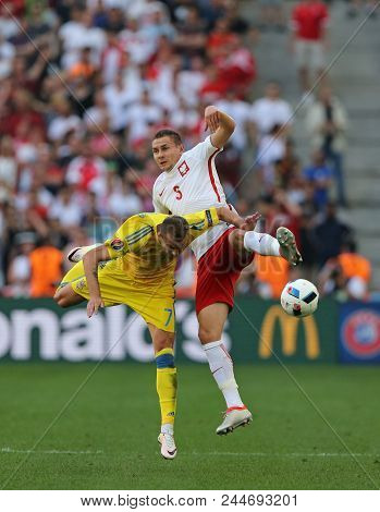 Marseille, France - June 21, 2016: Andriy Yarmolenko Of Ukraine (l) And Artur Jedrzejczyk Of Poland