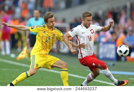 Marseille, France - June 21, 2016: Bohdan Butko Of Ukraine (l) Fights For A Ball With Jakub Blaszczy