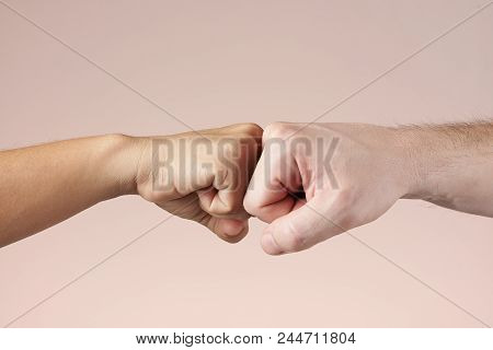 Two Fists Bumping Each Other. Fight Or Deal Concept. Teamwork And Strength Of Two People. Hands Bump