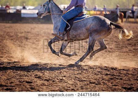 Cowboy Riding Competing In Campdrafting Event At A Country Rodeo, A Unique Australian Sport Involvin