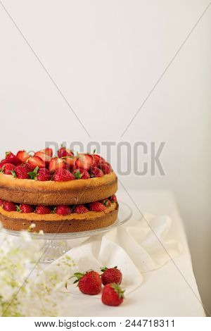 Homemade Strawberry Cake On A Glass Stand On The White Background. Selective Focus.