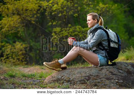 Young Woman Traveler Hiking In Summer Forest And Stopped To Have Rest With Cup Of Tea. Travel, Hikin