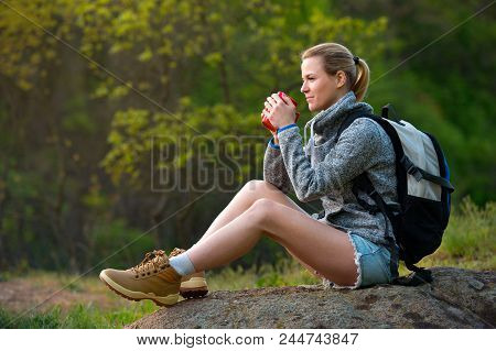 Woman Backpacker Hiking In Summer Forest And Stopped To Have Rest With Cup Of Tea. Travel, Hiking, B