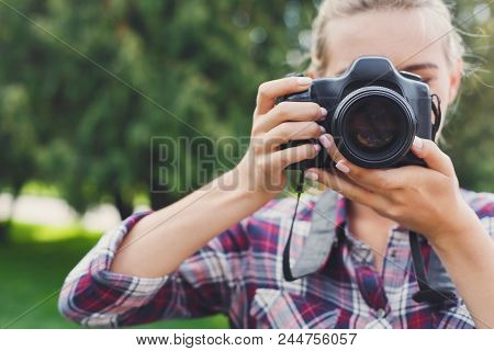 Attractive Young Woman Photographing With Professional Camera Outdoors, Copy Space. Taking Photos An