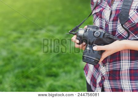 Unrecognizable Attractive Young Woman Photographing Outdoors, Watching Pictures On Professional Came