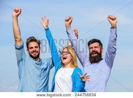 Freedom Concept. Company Three Happy Colleagues Office Workers Enjoy Freedom, Sky Background. Men Wi
