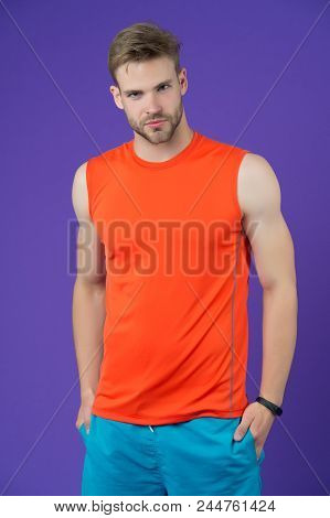 Confident Sportsman. Man Handsome Sports Clothing Violet Background. Athlete Sportsman Confident Put