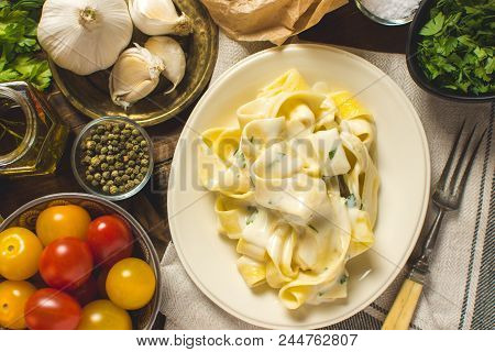 Alfredo Pasta Plate With Creamy Cheese And Basil Sauce