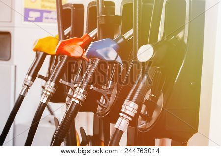Close Up Of Petroleum Gasoline Station Service - Oil Refueling And Refilling For Car Transportation