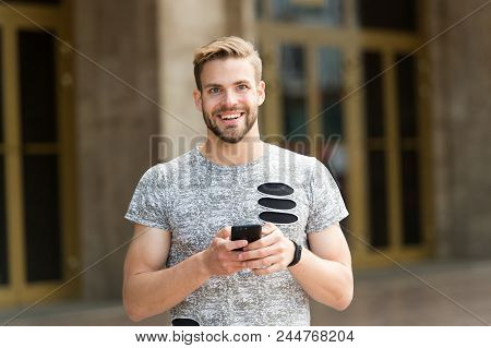 Staying In Touch. Send Message Concept. Man With Beard Walks With Smartphone, Urban Background. Guy