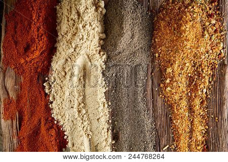 Colorful Spice Background With Different Color Spices, Macro, Selective Focus, Shallow Depth Of Fiel