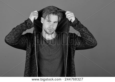 Sports Fashion And Confidence Concept. Man With Fair Hair On Purple Background. Macho With Confident