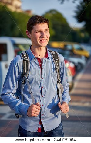 Cheerful Teenager With Some Skinmoles On His Face And Neck Is Smiling While Going Out. Emotional Sho