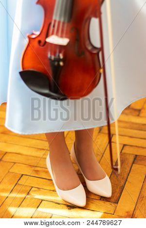 Young Violinist Blue Dress Holds Violin Fiddlestick.
