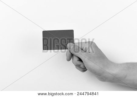 Advertising And Introducing Concept. Male Hand Holds Dark Green Card. Piece Of Paper In Close Up And