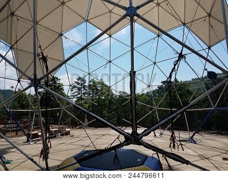 Geodesic Dome With Metal Poles And Triangles And Ropes